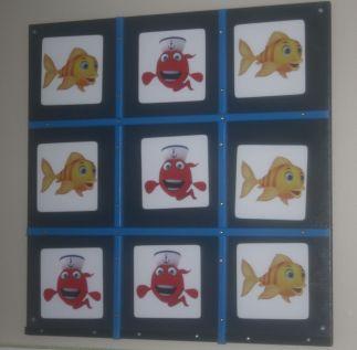 wandbord drie op een rij vissen